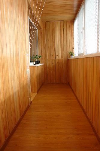 Обшивка балкона вагонкой с дерева